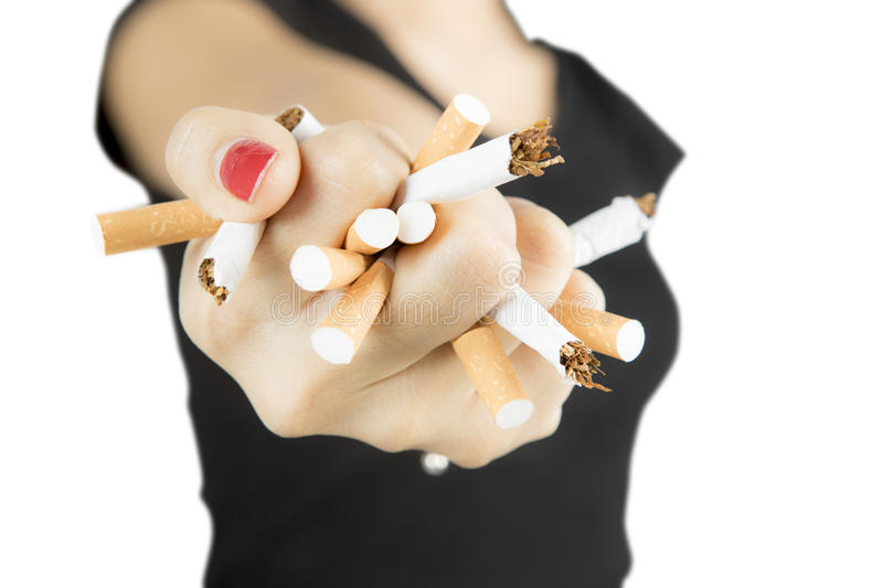 Woman destroys cigarettes in her hand stock images