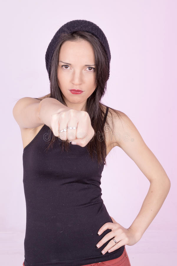 Woman determined throwing a punch royalty free stock image