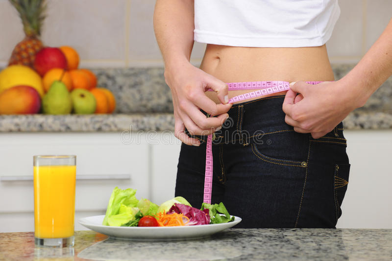 Woman on diet eating salad stock image