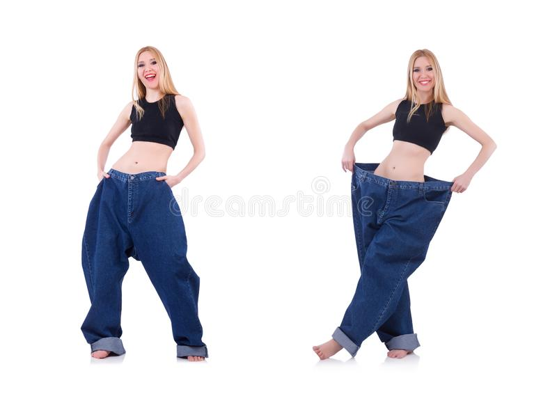 Woman in dieting concept with big jeans stock photo