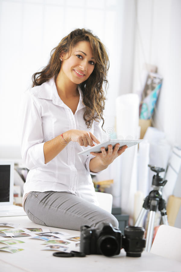 Woman and digital tablet stock image