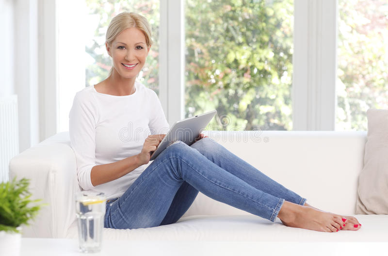 Woman with digital tablet stock photography