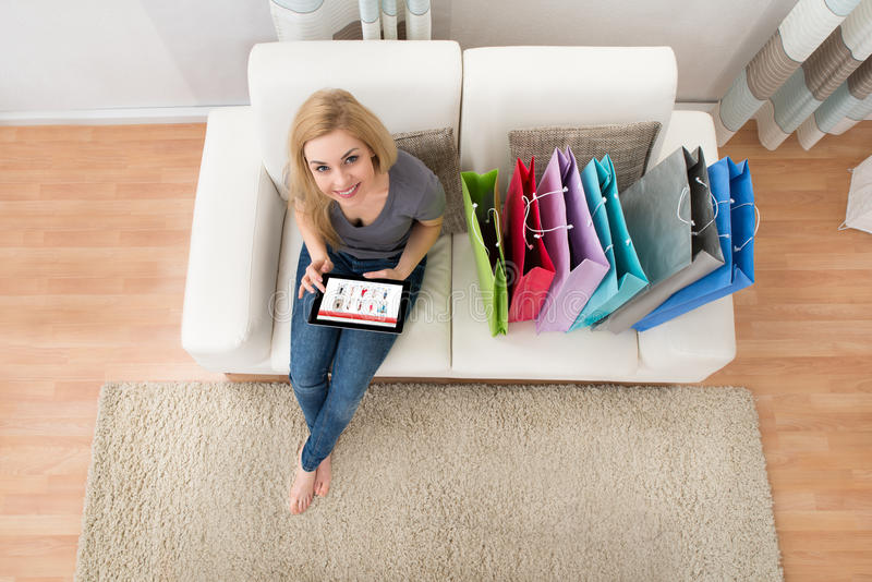 Woman With Digital Tablet Shopping Online stock photography