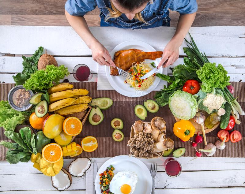 The woman at the dinner table with organic food , the view from the top royalty free stock image