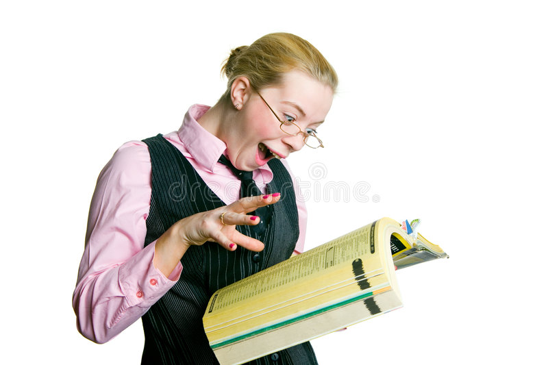 A Woman With A Directory. A young pretty woman is wondering about something in the directory stock photo