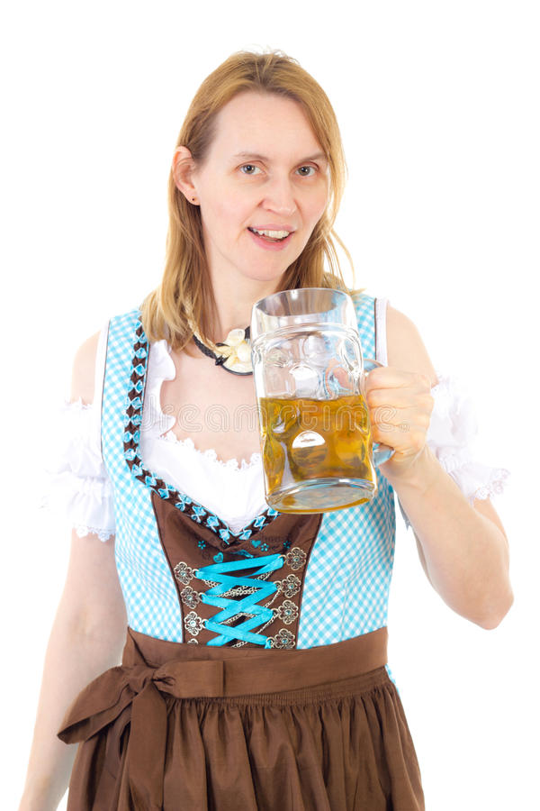 Woman with dirndl and beer at Oktoberfest royalty free stock photos