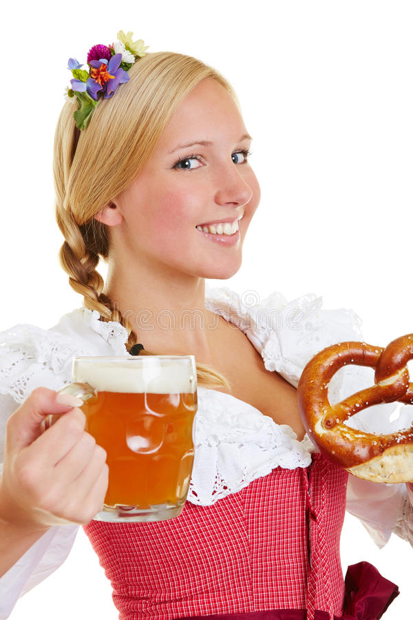 Woman In Dirndl With Pretzel And Beer Royalty Free Stock Images