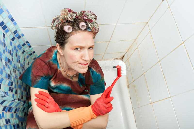 Woman and dirty bathroom royalty free stock images