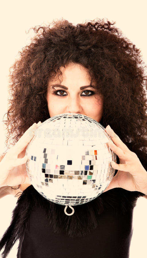 Woman with disco ball stock photo