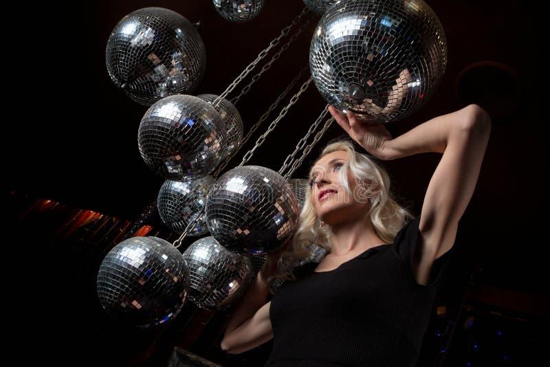 Woman disco mirror ball stock image