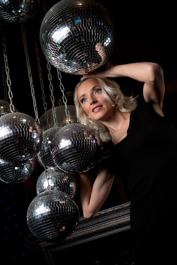 Woman disco mirror ball stock photos