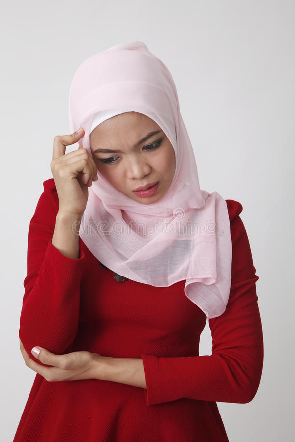 Woman discomfort. Malay woman not feeling well royalty free stock photo