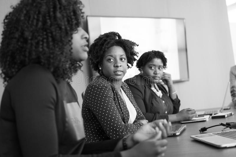 Woman Discussing With Her Colleagues royalty free stock photo