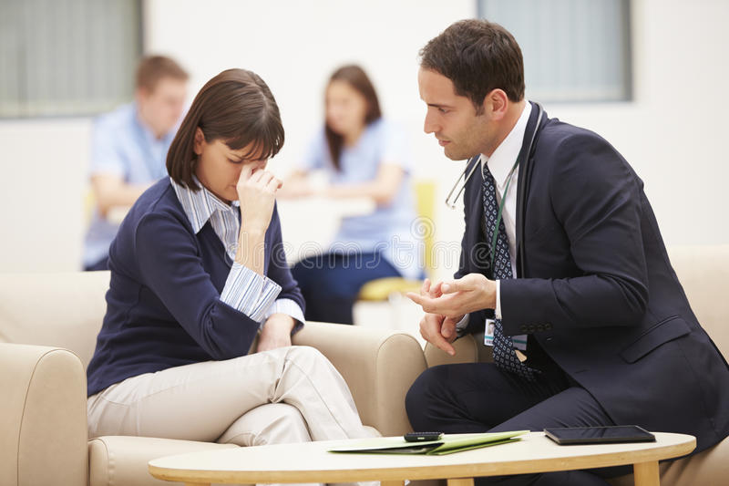 Woman Discussing Test Results With Doctor royalty free stock photography