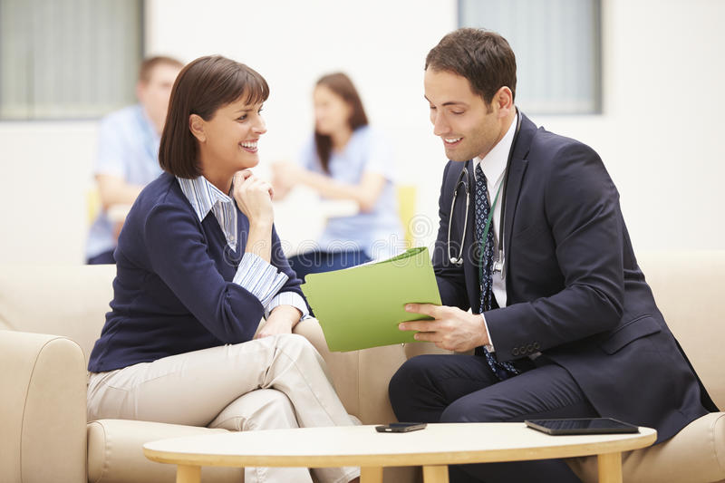 Woman Discussing Test Results With Doctor royalty free stock image