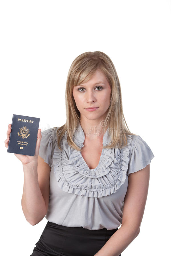 Woman displaying US Passport. A blonde woman holding up a United States issued passport stock images