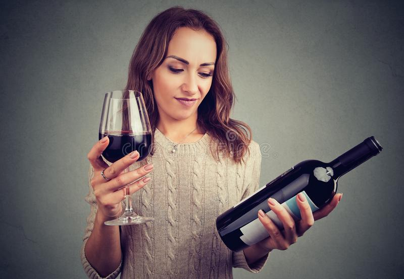 Woman displeased with wine taste stock image