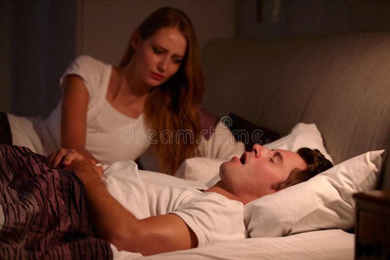 Woman Disturbed By Man's Snoring As They Lie In Bed stock images