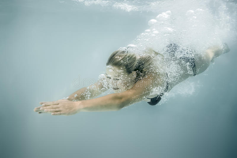 Woman diving. An image of a beautiful diving woman royalty free stock images