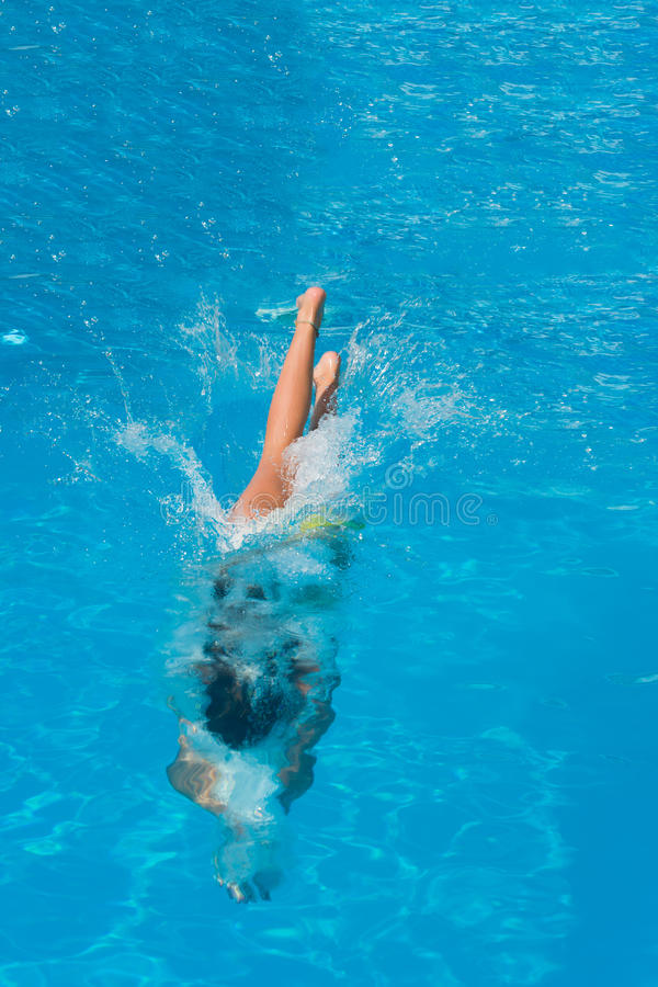 Woman Diving In The Swimming Pool Royalty Free Stock Photo