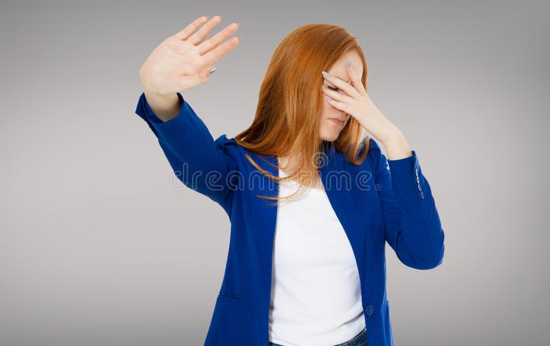 Woman do facepalm and rejection something on gray background copy space stock photo
