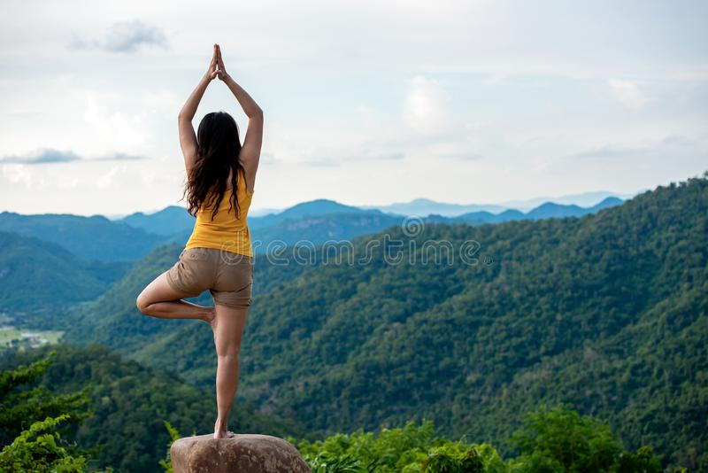 Woman do yoga lifestyle balance practicing and zen in outdoor. Woman exercising vital and meditation for fitness lifestyle club at stock image