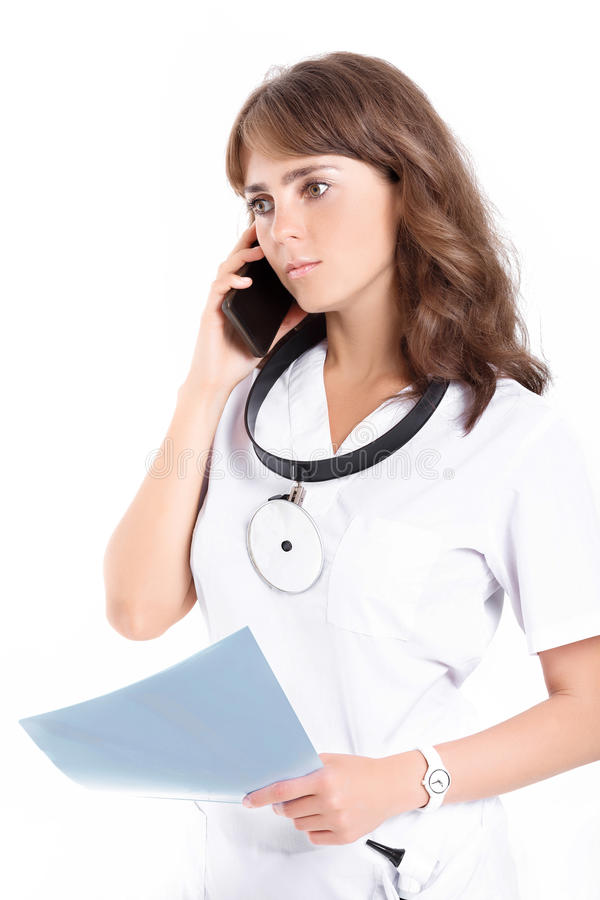 Woman doctor ENT. Female ENT doctor with a folder and a front reflector on the phone stock photos
