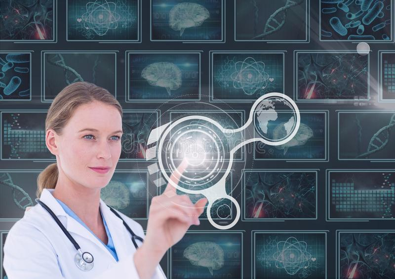 Woman doctor interacting with interfaces against background with medical interfaces royalty free stock photos