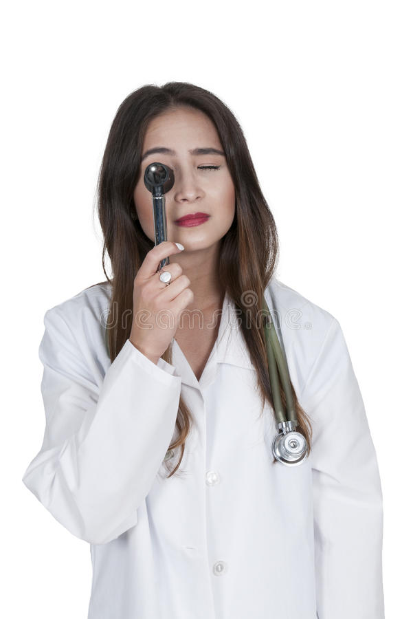 Woman doctor with an otoscope royalty free stock photos