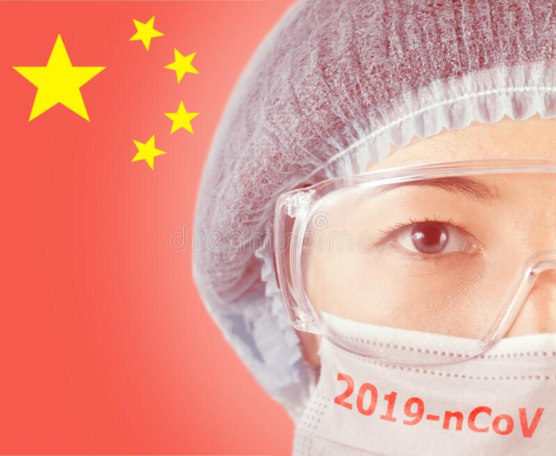 Woman doctor in protective mask with inscription 2019-nCov. royalty free stock images