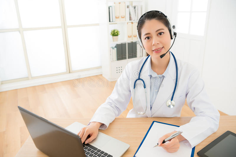 Woman doctor provides service for online royalty free stock photography