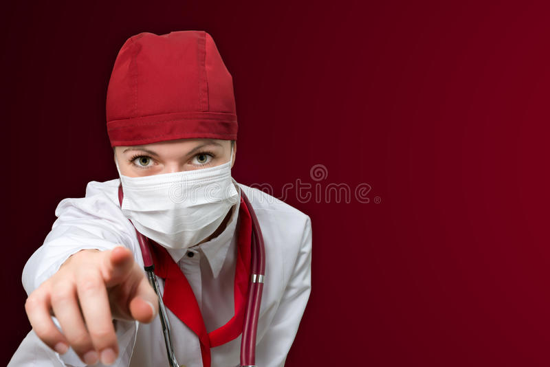Woman doctor with red background stock photo