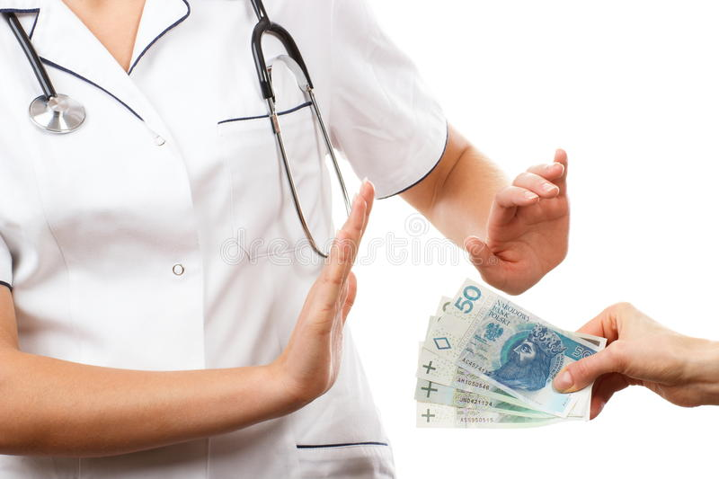Woman doctor refusing bribes or kickbacks, concept of corruption stock photography