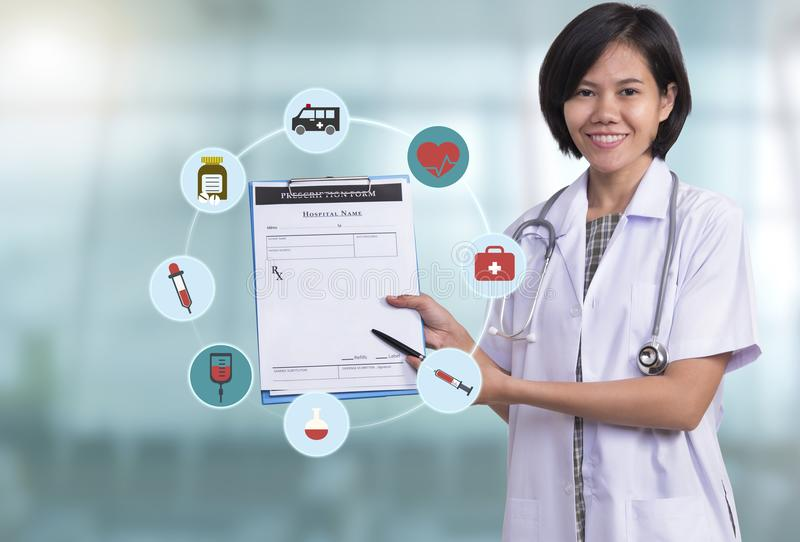 Woman doctor stand at hospital corridor. holding prescription royalty free stock photos