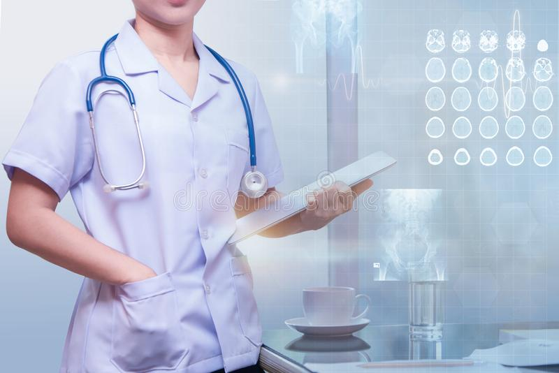 Woman doctor standing in working room stock photos