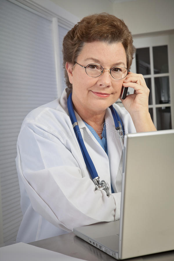 Download Woman Doctor Talking On Phone Stock Photo - Image: 11911148