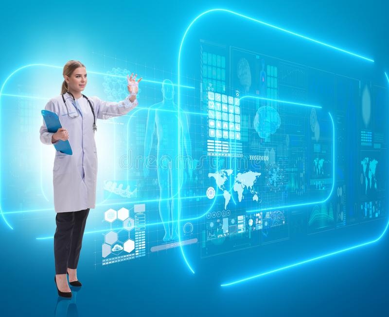 Woman doctor in telemedicine futuristic concept stock photos