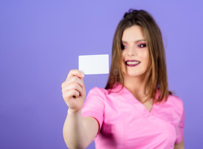 Woman doctor uniform. Doctor hold business card copy space. Private clinic. Medical insurance payment for services. Medical help. Insurance medicine. Health stock photo