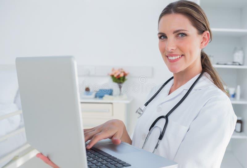 Woman doctor using laptop