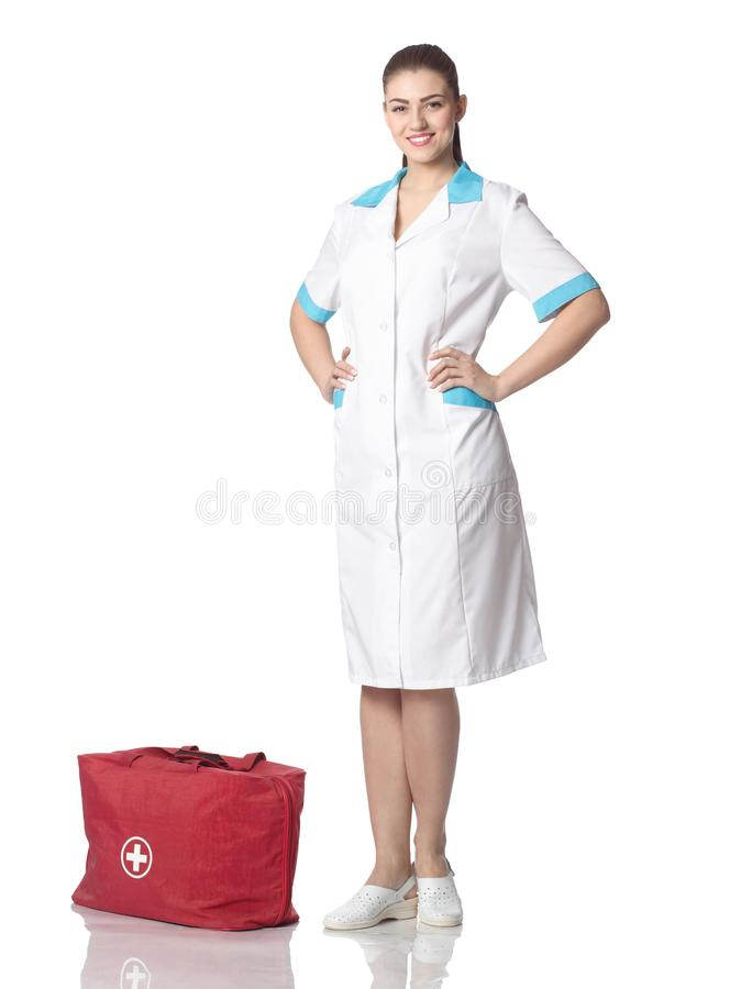 Woman doctor in white medical dressing gown with red bag with me royalty free stock image
