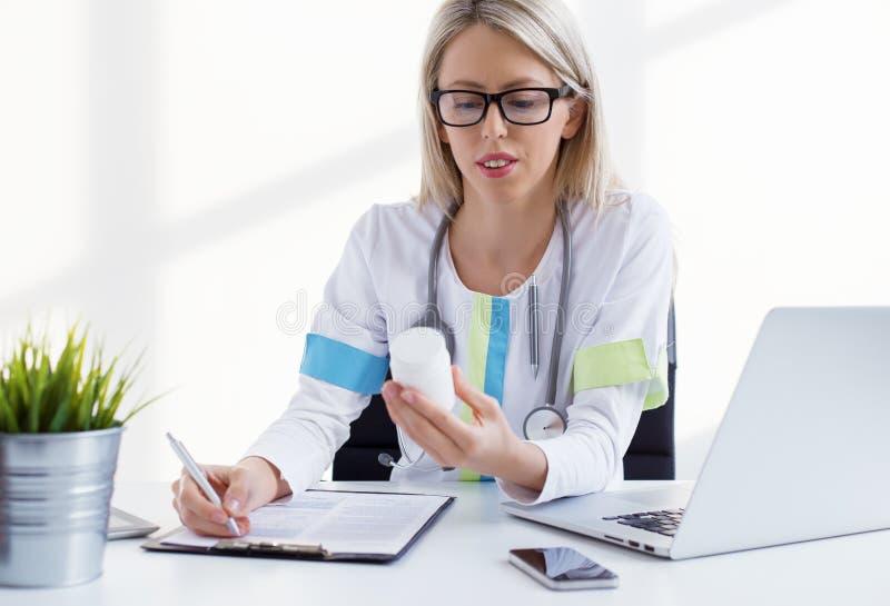 Woman doctor writing medicine prescription stock photos