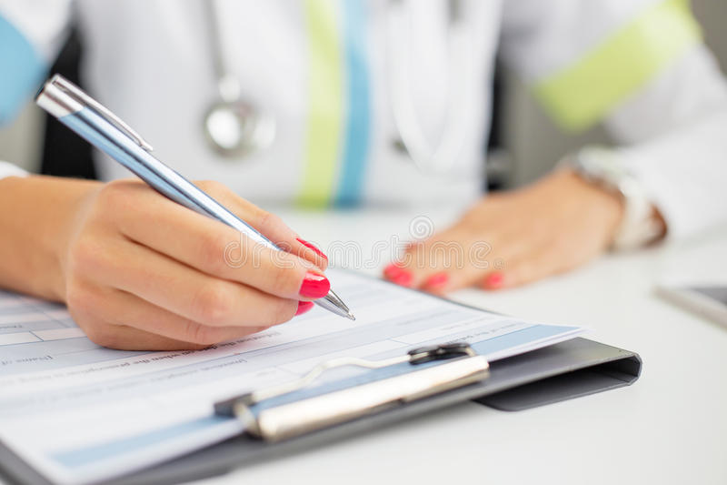 Woman doctor writing stock photo