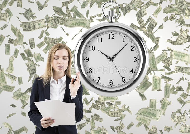 Woman with documents in a room with a stopwatch and dollars royalty free stock photography