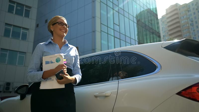 Woman with documents sincerely smiling, starting her own business, good news. Stock photo stock image