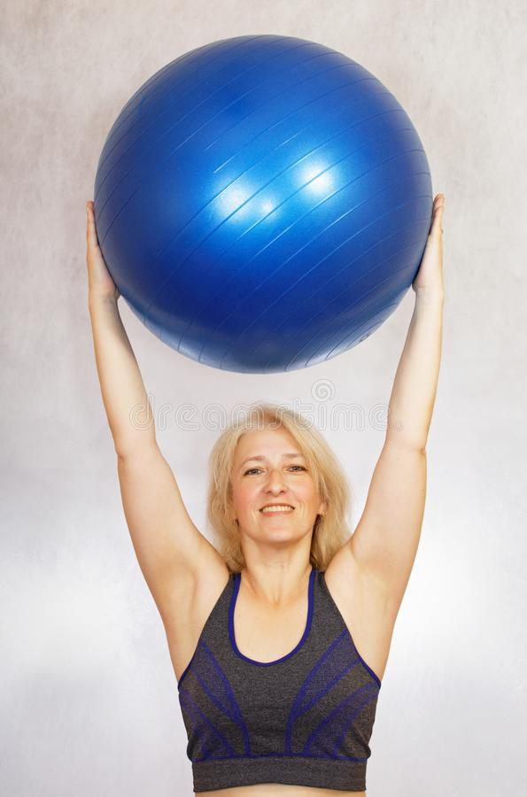 A woman does exercises from pilates at home royalty free stock photography