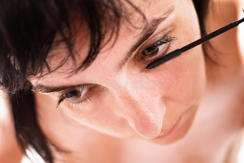 Woman does make-up, soft face stock image