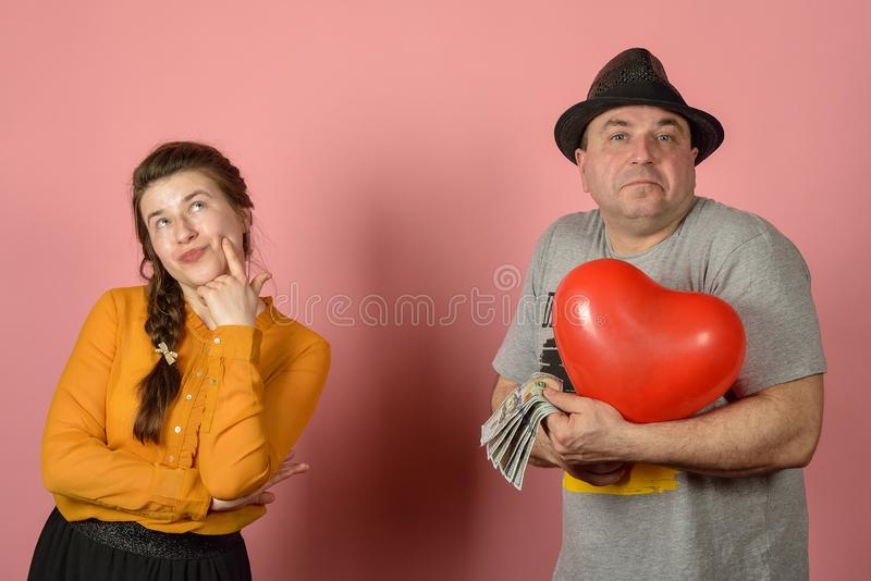 A woman does not want to accept gifts from a man, congratulations and conflicts among lovers stock images