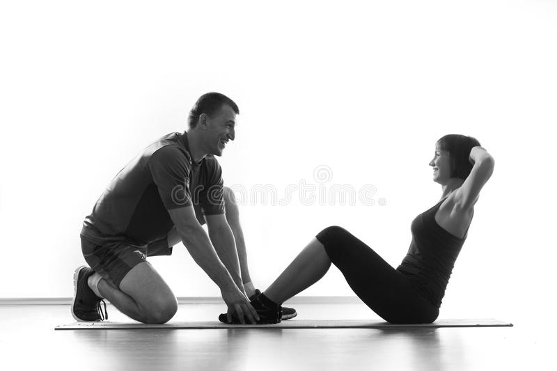 Woman does situps with coach royalty free stock photos