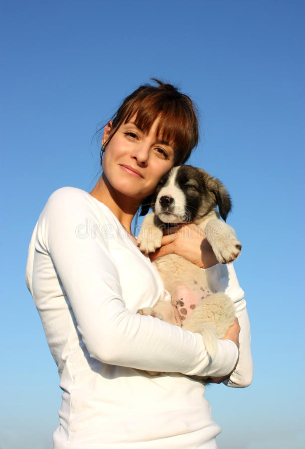 A woman with dog. A white woman with dog isolated on sky