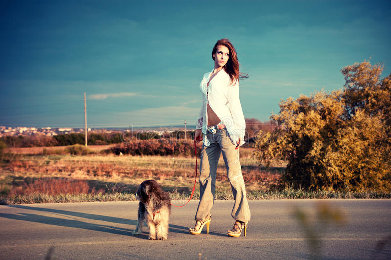 Download Woman And Dog Royalty Free Stock Photography - Image: 19245337
